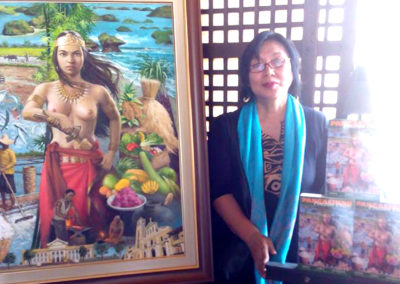Author Gie Pasalo with book cover painting